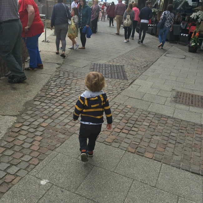 toddler-walking-in-busy-street