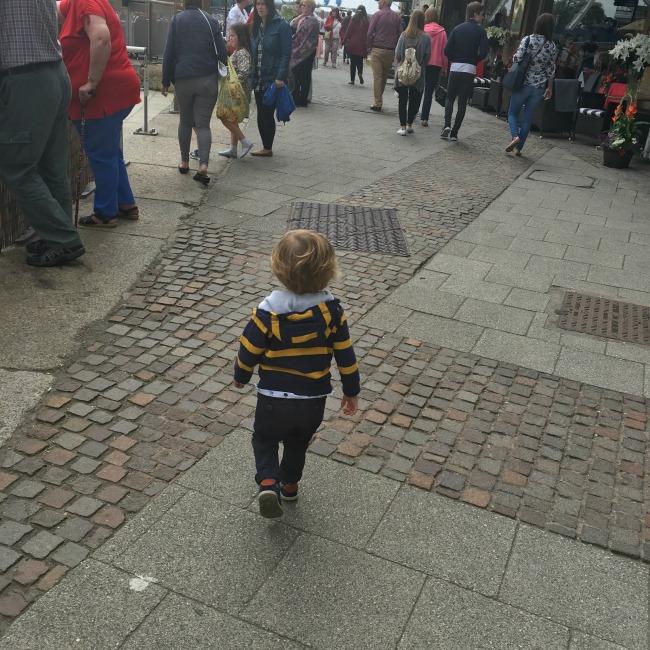 toddler-walking-in-busy-street