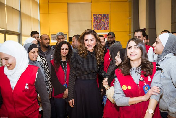 Queen Rania wore A.W.A.K.E. Unbutton Me please top. Queen visited exhibits at the Children's Museum before attending its board meeting