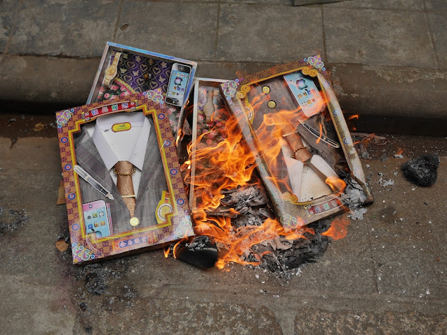 boxes with paper shirts, ties, and suits jacket burn