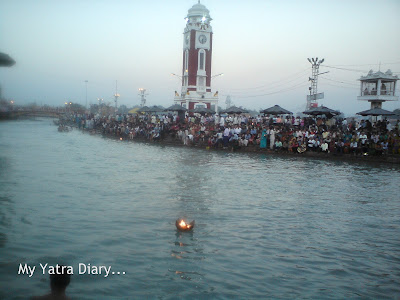 A diya floats atop the River Ganga at the Har Ki Pauri Ghat in Haridwar