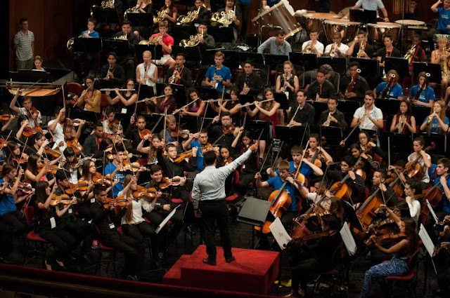 The Sistema Europe Youth Orchestra, conducted by Bruno Campo of Guatemala, rehearses at Teatro alla Scala in Milan. August 2015. (Photo Rey Trombetta)