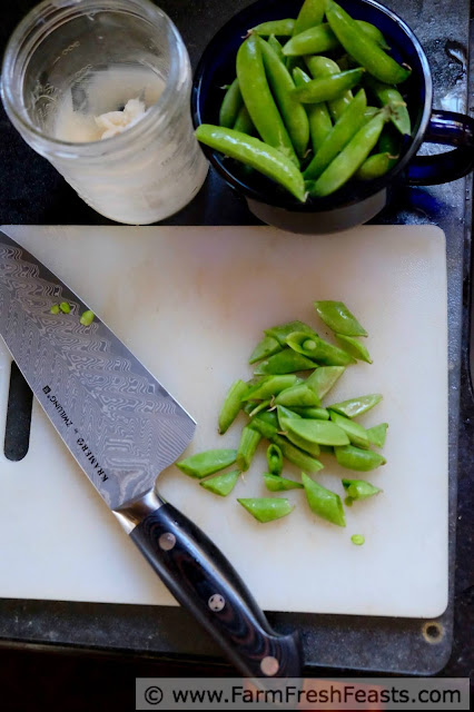 photo of sugar snap peas sliced on the diagonal