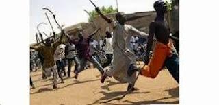 Muslim fighting Christians in Nigeria