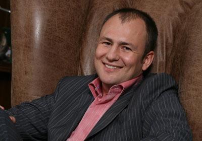 Andrey Melnichenko, Muda dan Kaya Raya