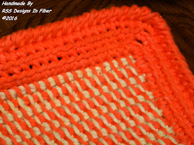 Closeup of Tunisan Crochet Tweed Pot Holder in Orange and Cream by Ruth Sandra Sperling - RSS Designs In Fiber