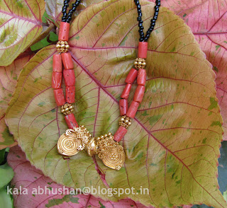 coral and gold mangalsutra