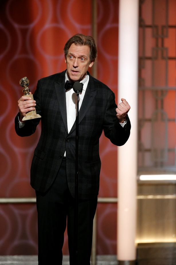 Actor-Hugh-Laurie-holds-his-award-for-Best-Supporting-Actor-SeriesLimited-SeriesTV-Movie-for-Th