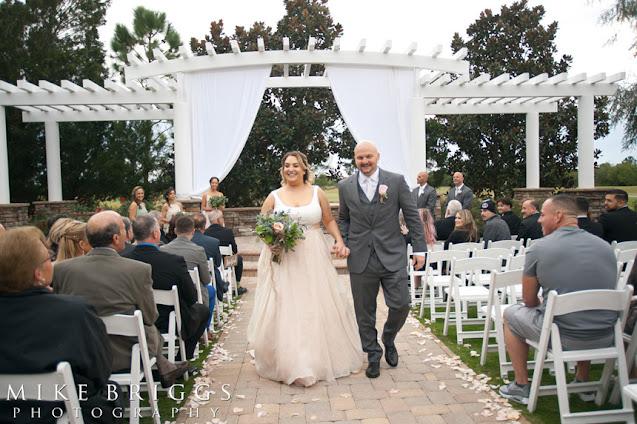 newlyweds walking down aisle together