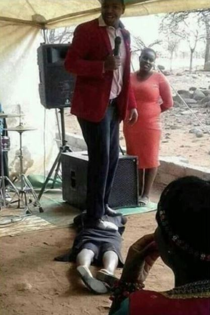 Awkward Picture Of Pastor Standing On Woman Goes Viral