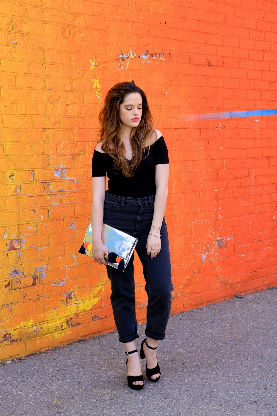 Fashion blogger Kathleen Harper wearing mom jeans with off-the-shoulder bodysuit