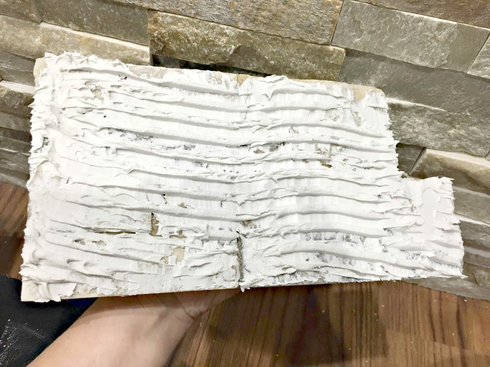 how to put stacked stone on fireplace