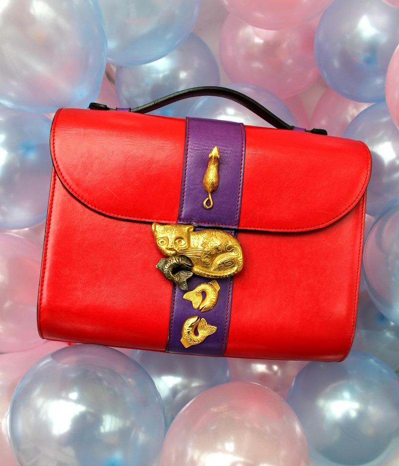 stored and adored designer bag blog: vintage red leather bag with metal embellishments