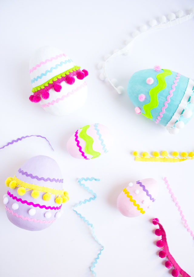 Make these colorful pom-pom trim Easter eggs from giant paper mache eggs!