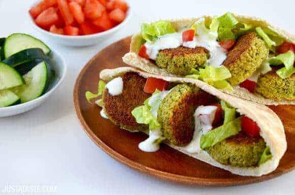 falafel in pita bread with tahini sauce and veggies