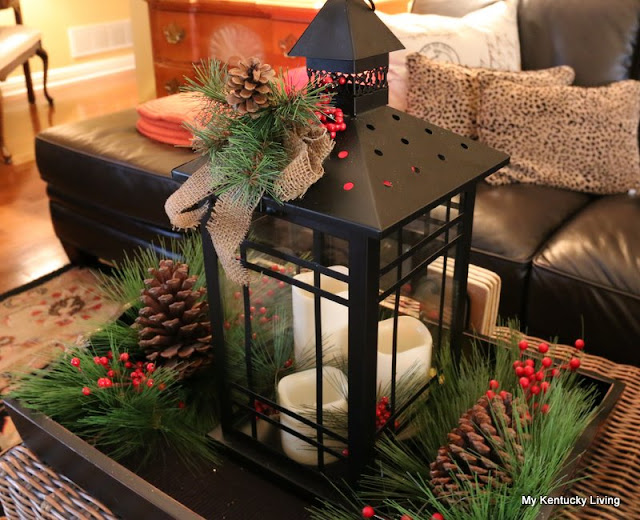black lantern, pine cones, pine branches