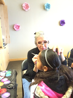 A Face Painter Painting a young girls face