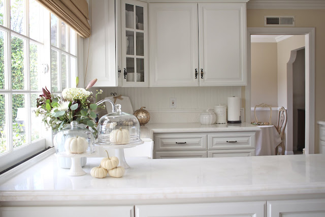 fall home tour autumn decor inspiration flowers white pumpkins in white kitchen