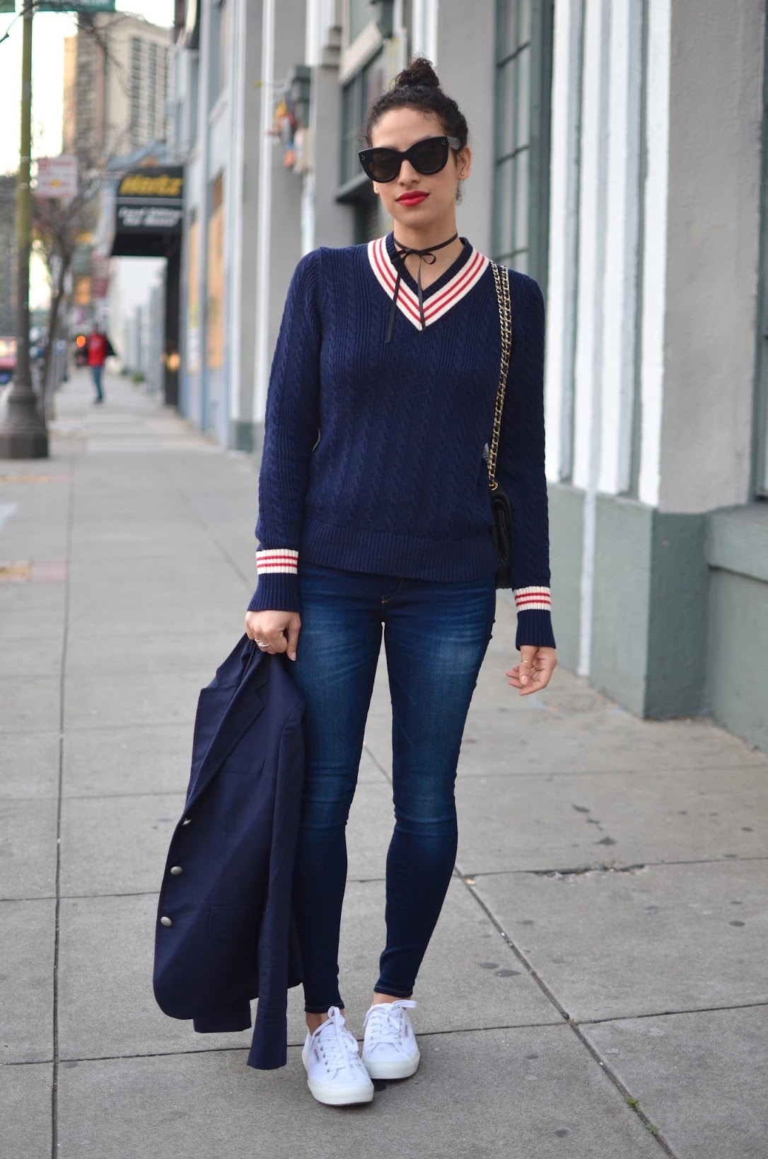cricket sweater, how to wear a cricket sweater, Ines de la Fressange x Uniqlo cricket sweater, how to style white canvas sneakers, white sneakers, ribbon as a necklace, all navy, Unqilo, True Religion, Céline cateye sunglasses, Estee Lauder red lipstick