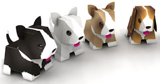 http://www.paper-toy.fr/2012/08/29/puppies-papertoys-de-julius-perdana/