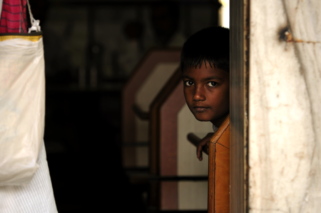 Boy in Dharavi, Mumbai, India submitted to the weekly challenge 'Framed Through Doors and Windows' on Better Photography.