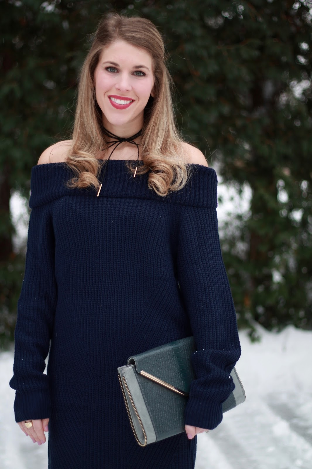 navy off the shoulder sweater dress, fleece tights, grey over the knee boots, grey envelope clutch