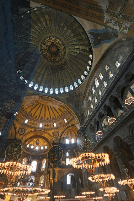 Great interior design of the domes and lights in Hagia Sophia at Sultanahmet in Istanbul, Turkey