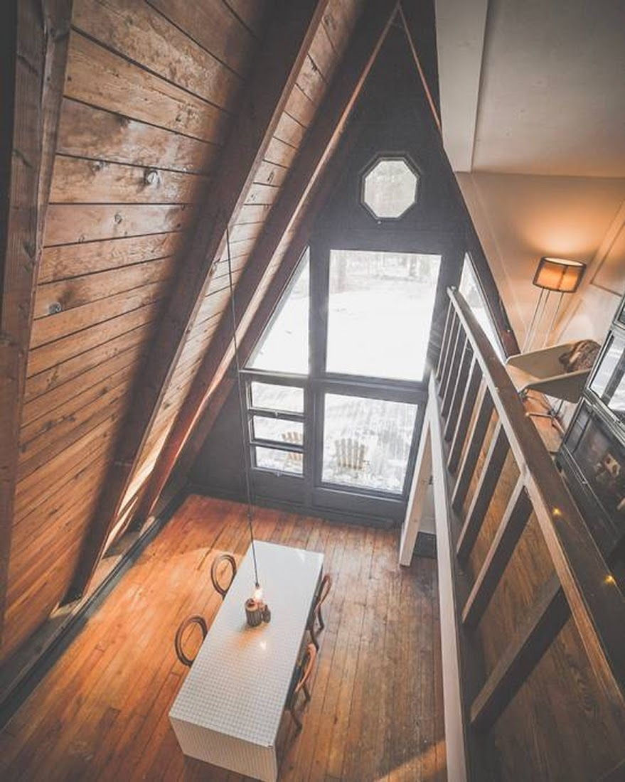 02-Dining-Room-from-Above-Jeremy-Sustainable-Catskills-A-Frame-House-Airbnb-www-designstack-co