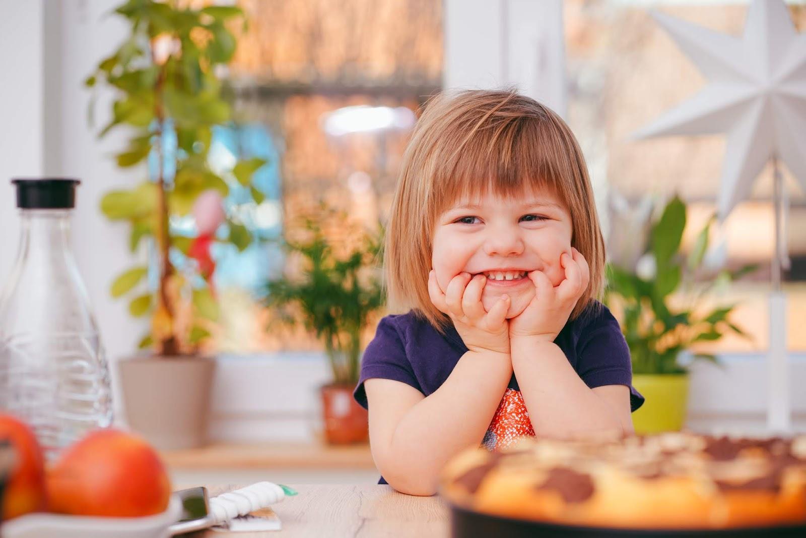 NAMC Montessori cosmic education and world food day. Girl eating.