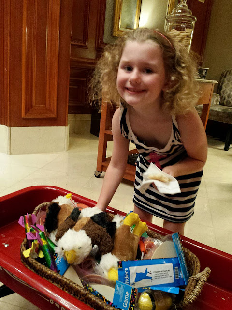 A traveler's look at family-friendly hotel packages at the Ritz-Carlton Washington D.C. The Lions,Tigers, Bears...Oh My! Package ties in with the National Zoo.  The Red Wagon is a favorite amenity for children.
