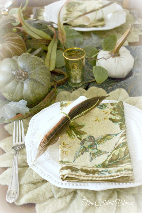 A Festive Fall Pumpkin Table-   Set an autumn table with feathers and pumpkins!  www.gildedbloom.com  #tablesetting