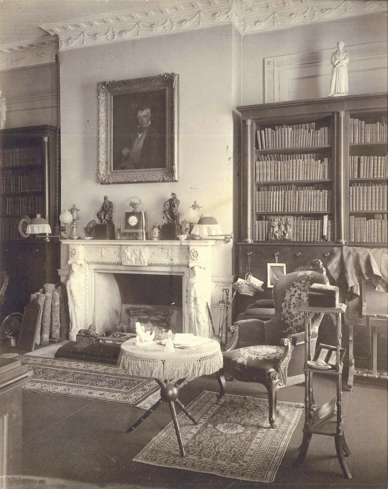 A black and white photograph of a richly decorated library.