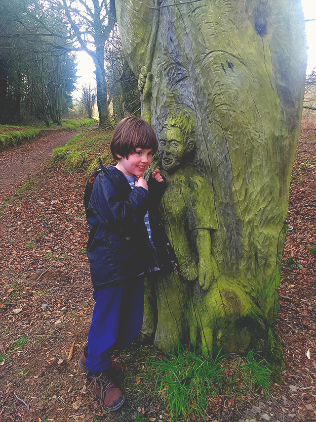 carved boy tree trunk