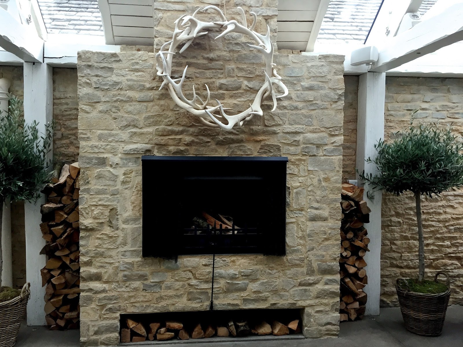 wood fireplace and logs