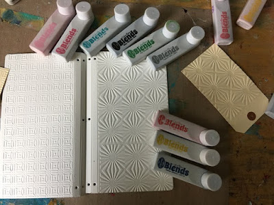 Shows embossed mat board covers & color blend inks in multiple colors.