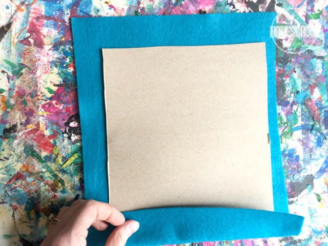 tape felt sheet onto cardboard rectangle