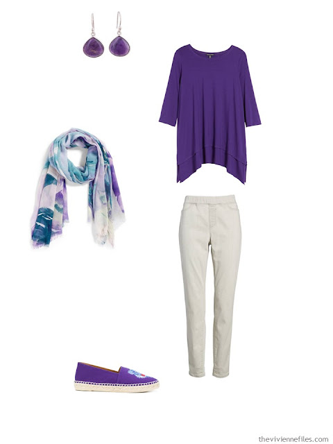 wearing an ultraviolet tunic with light grey pants