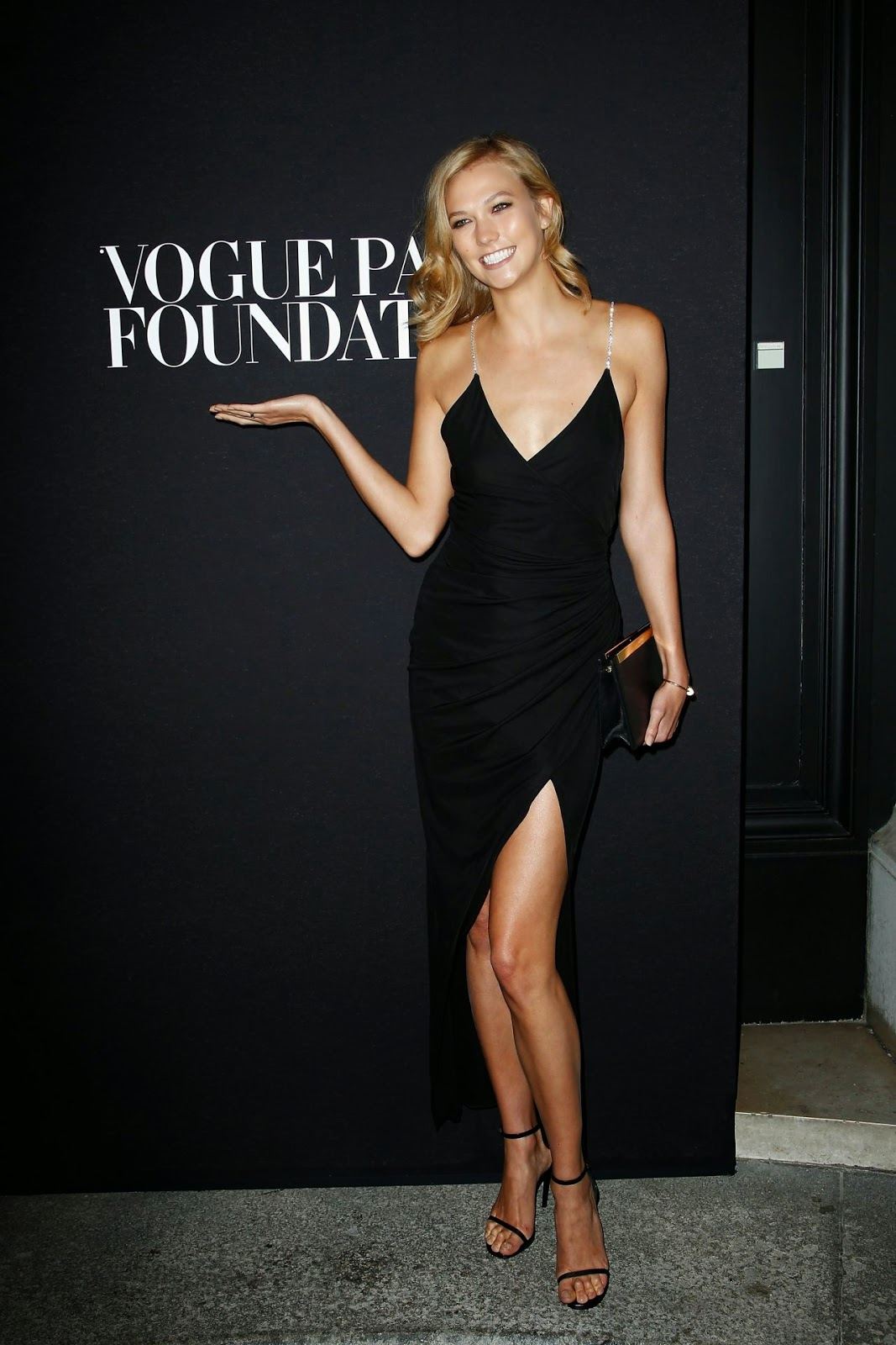 Karlie Kloss In A Slinky Black Dress With A Thigh Slit At
