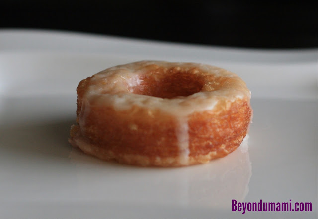Cronut with passion-fruit glaze.