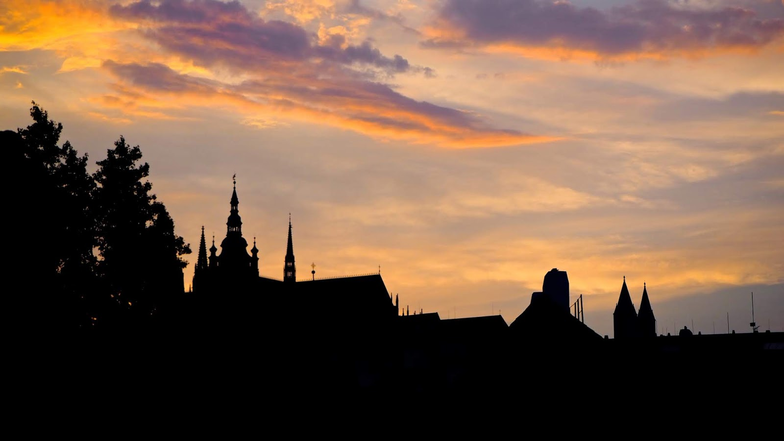 Colourful skies and the Prague Skyline in Silhouette during sunset