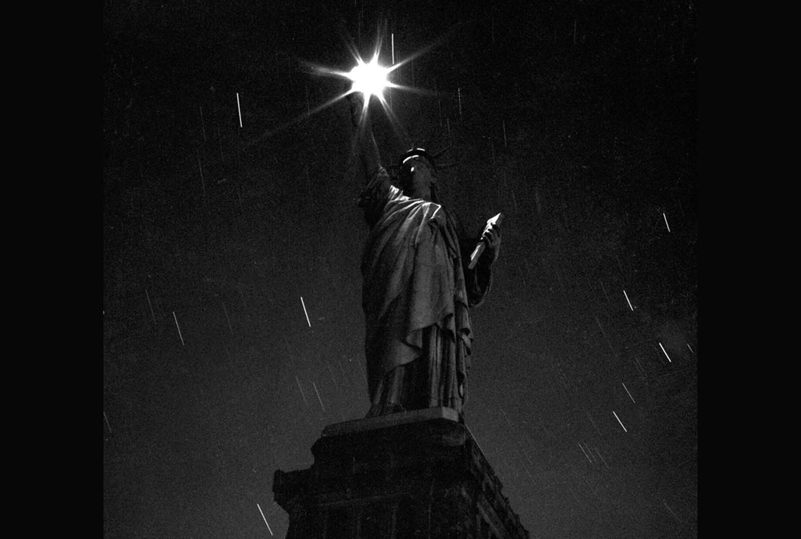 A view of the statue taken at night, during a blackout designed to help conserve energy during World War II, in March of 1942.