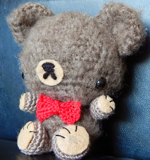 http://yarnplanet.tumblr.com/post/49516732846/mini-bowtie-bear-pattern-sometime-ago-some