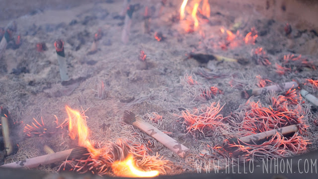 burning incense at Senzo Temple
