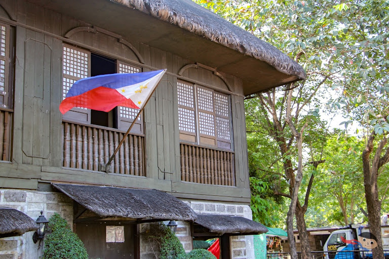 National Flag and Ancestral-looking house in Rizal Park
