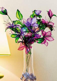 http://www.portaldeartesanato.com.br/materias/2430/buqu%C3%AA+de+flores+recicladas