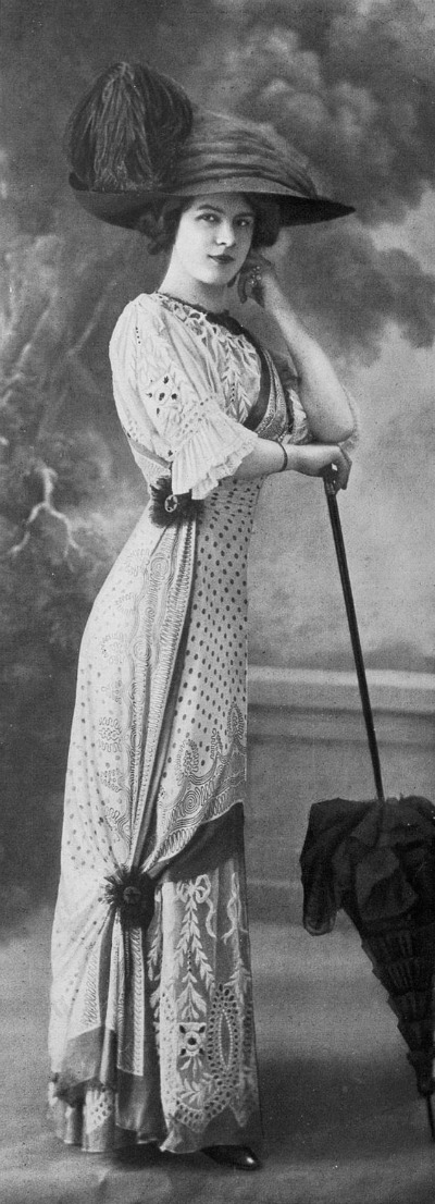 Fashionably dressed woman from 1910 standing for photograph