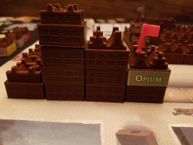 stacked opium warehouses in chartered board game
