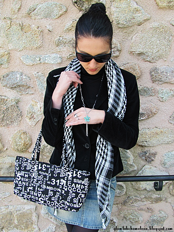 black outfit with denim skirt and black white printed accessories