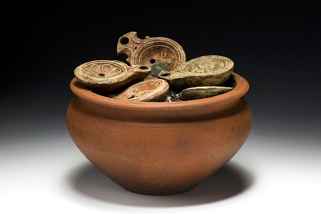 Roman pot filled with lamps and bronze coins found in Switzerland