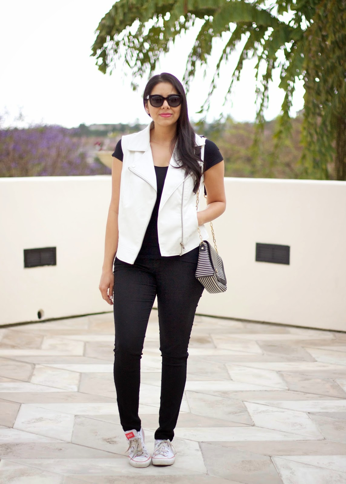 black and white edgy outfit, moto vest on black ootd, casual cool look